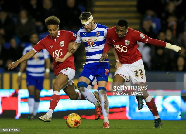 Reading's Chris Gunter battles with Bristol City's Bobby Reid and Jonathan Kodjia