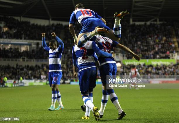 Reading's Chris Gunter celebrates with teammates after Arsenal's Laurent Koscielny scores an own goal