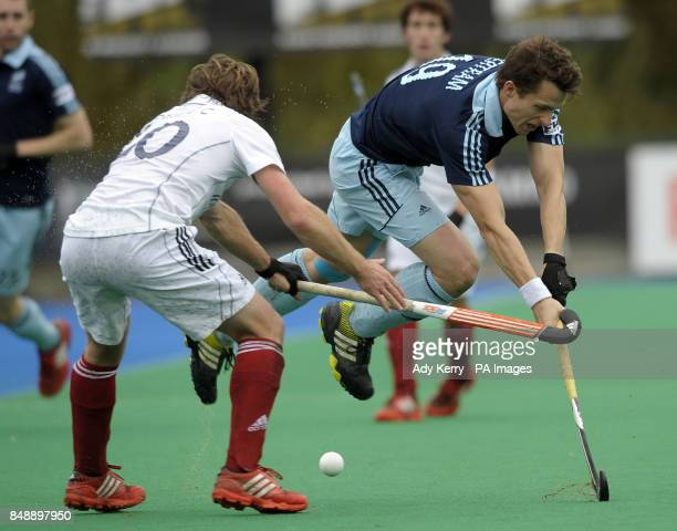Reading's Chris Newman challenges with Saint Germain's Charles Verrier during the EuroHockey League Round 12 game at East Grinstead HC West Sussex