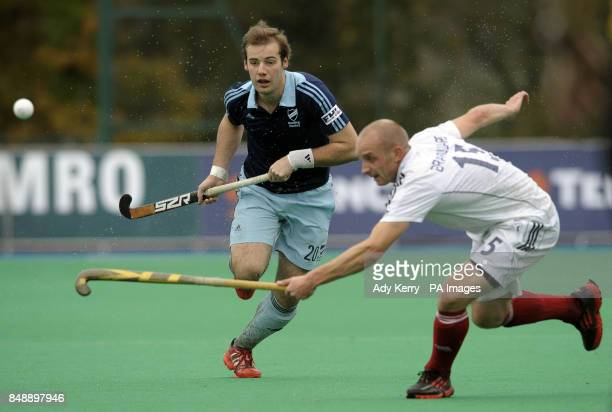 Reading's Chris Newman challenges with Saint Germain's Gerome Branquart during their EuroHockey League Round 12 game at East Grinstead HC West Sussex...
