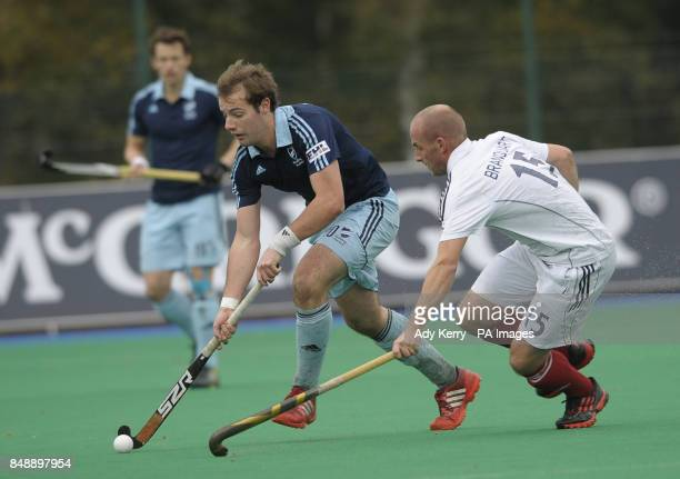 Reading's Chris Newman challenges with Saint Germain's Gerome Branquart during the EuroHockey League Round 12 game at East Grinstead HC West Sussex