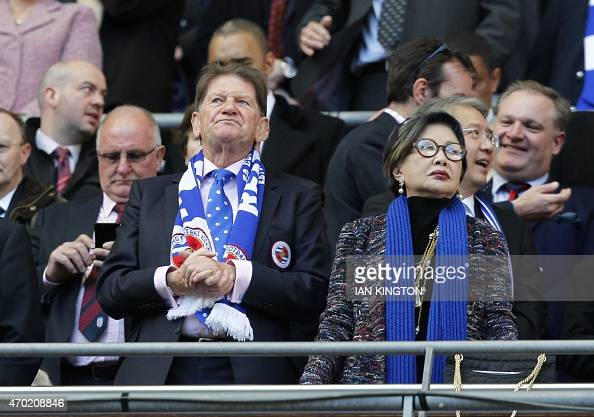 Reading's cochairman Sir John Madejski and new owner Thai businesswoman Khunying Sasima Srivikorn stand prior to the start of the FA Cup semifinal...