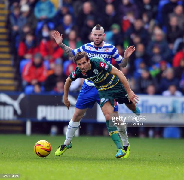 Reading's Danny Guthrie and QPR's Gary O'Neil challenge for the ball