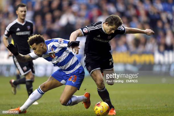 Reading's Danny Williams and Brentford's James Tarkowski battle for the ball