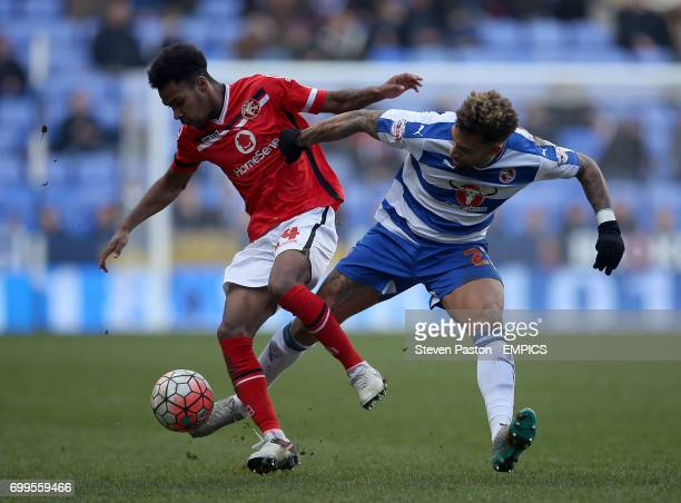 Reading's Danny Williams and Walsall Rico Henry battle for the ball