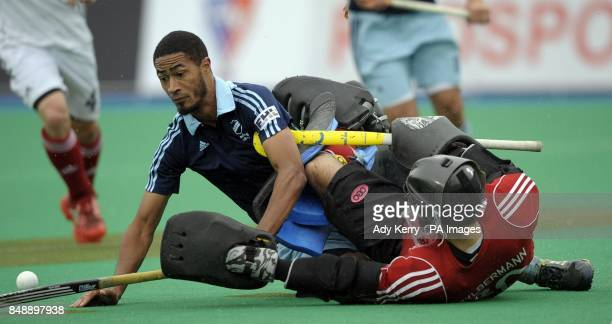 Reading's Darren Cheesman challenges with Saint Germain's Martin Zybermann during the EuroHockey League Round 12 game at East Grinstead HC West Sussex