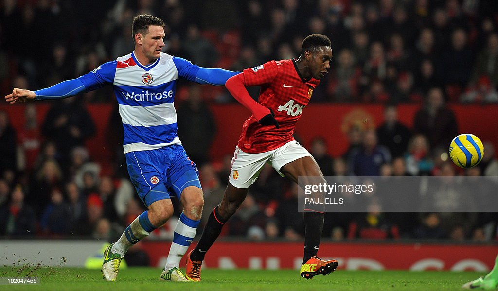 "Reading's English defender Sean Morrison (L) pulls back Manchester United's English striker Danny Welbeck (R) during the English FA Cup fifth round football match between Manchester United and Reading at Old Trafford in Manchester, north west England, on February 18, 2013. USE. No use with unauthorized audio, video, data, fixture lists, club/league logos or ""live"" services. Online in-match use limited to 45 images, no video emulation. No use in betting, games or single club/league/player publications."
