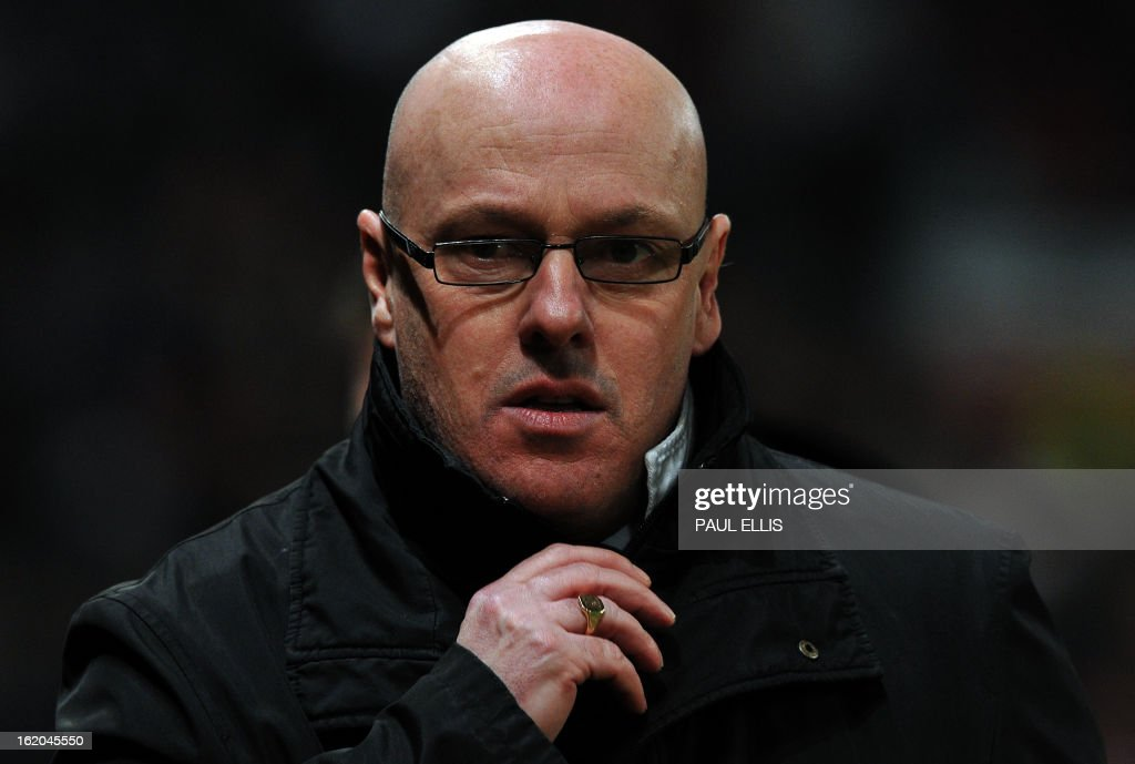 "Reading's English manager Brian McDermott arrives for the English FA Cup fifth round football match between Manchester United and Reading at Old Trafford in Manchester, north west England, on February 18, 2013. USE. No use with unauthorized audio, video, data, fixture lists, club/league logos or ""live"" services. Online in-match use limited to 45 images, no video emulation. No use in betting, games or single club/league/player publications."