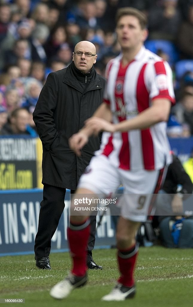 "Reading's English manager Brian McDermott (L) looks on during the FA Cup fourth round football match between Reading and Sheffield United at the Madejski Stadium in Reading on January 26, 2013. Reading won the game 4-0. USE. No use with unauthorized audio, video, data, fixture lists, club/league logos or ""live"" services. Online in-match use limited to 45 images, no video emulation. No use in betting, games or single club/league/player publications."