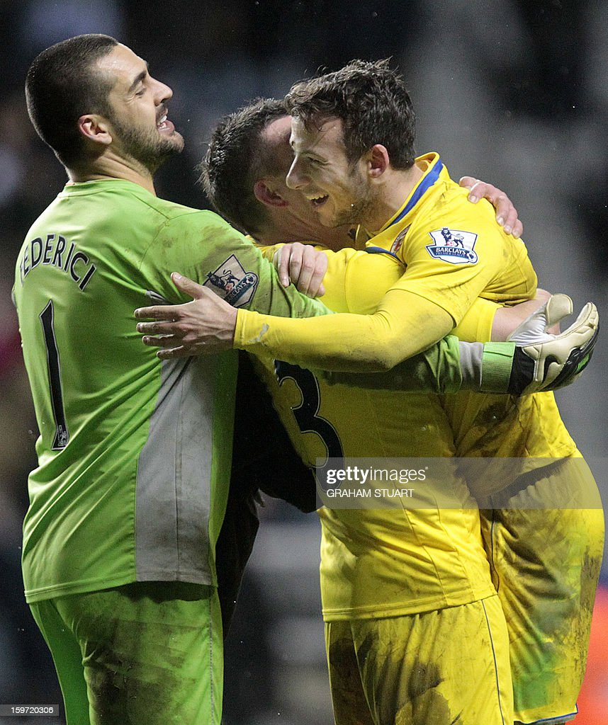 "Reading's English striker Adam Le Fondre (R) celebrates at the final whistle with Australian goalkeeper Adam Federici (L) and Irish defender Ian Harte (2L) after a 2-1 victory in the English Premier League football match between Newcastle United and Reading at St James' Park in Newcastle Upon Tyne, northeast England, on January 19, 2013. AFP PHOTO / GRAHAM STUART - RESTRICTED TO EDITORIAL USE. No use with unauthorized audio, video, data, fixture lists, club/league logos or ""live"" services. Online in-match use limited to 45 images, no video emulation. No use in betting, games or single club/league/player publications."