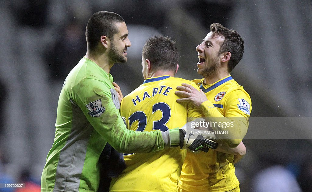 "Reading's English striker Adam Le Fondre (R) celebrates at the final whistle with Australian goalkeeper Adam Federici (L) and Irish defender Ian Harte (C) after a 2-1 victory in the English Premier League football match between Newcastle United and Reading at St James' Park in Newcastle Upon Tyne, northeast England, on January 19, 2013. AFP PHOTO / GRAHAM STUART - RESTRICTED TO EDITORIAL USE. No use with unauthorized audio, video, data, fixture lists, club/league logos or ""live"" services. Online in-match use limited to 45 images, no video emulation. No use in betting, games or single club/league/player publications."