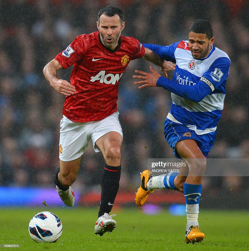"Reading's English-born Jamaican midfielder Jobi McAnuff (R) vies with Manchester United's Welsh midfielder Ryan Giggs during the English Premier League football match between Manchester United and Reading at Old Trafford in Manchester, north-west England on March 16, 2013. AFP PHOTO/ANDREW YATES RESTRICTED TO EDITORIAL USE. No use with unauthorized audio, video, data, fixture lists, club/league logos or ""live"" services. Online in-match use limited to 45 images, no video emulation. No use in betting, games or single club/league/player publications."