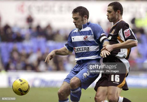 Reading's Graeme Murty challenges Hull's Damien Delaney during the CocaCola Championship match at the Madejski Stadium Reading Saturday November 19...