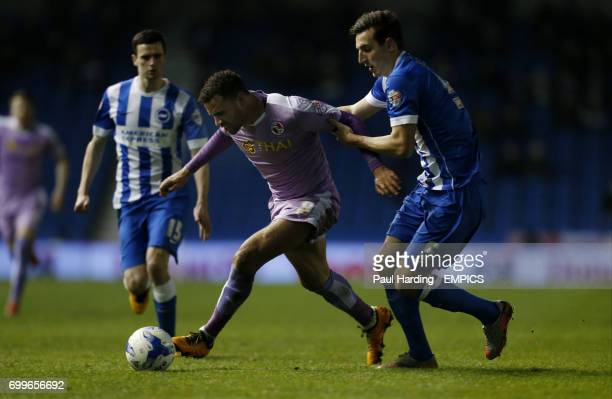 Reading's Hal RobsonKanu and Brighton and Hove Albion's Lewis Dunk