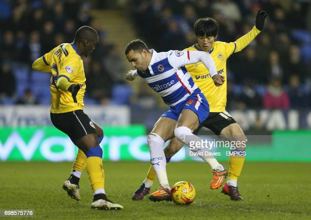 Reading's Hal RobsonKanu and Wigan Athletic's Kim BoKyung and MarcAntoine Fortune