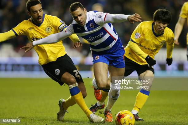 Reading's Hal RobsonKanu and Wigan Athletic's Kim BoKyung and James Perch