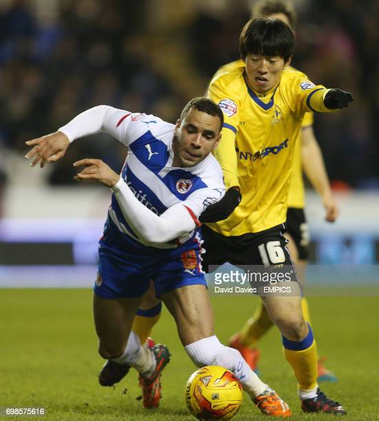 Reading's Hal RobsonKanu and Wigan Athletic's Kim BoKyung