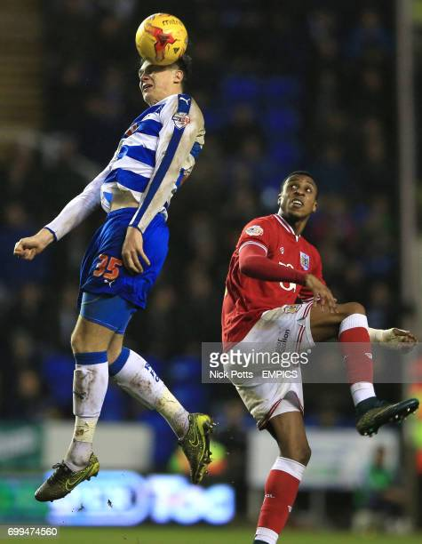 Reading's Jake Cooper and Bristol City's Jonathan Kodjia in action