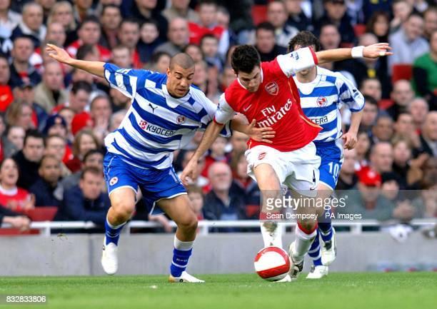 Reading's James Harper and Arsenal's Francesc Fabregas battle for the ball