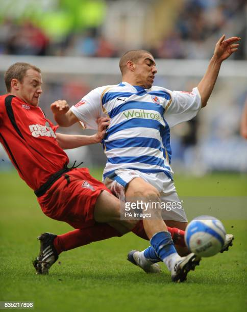 Reading's James Harper tackled by Ipswich Town's Alan Quinn during the CocaCola Championship match at the Madejski Stadium Reading