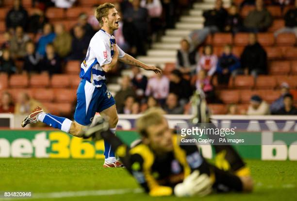 Reading's James Henry celebrates scoring during the Carling Cup Third Round match at Britannia Stadium Stoke