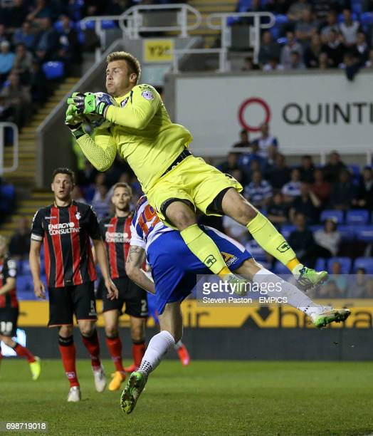 Reading's Jamie Mackie and AFC Bournemouth Artur Boruc collide
