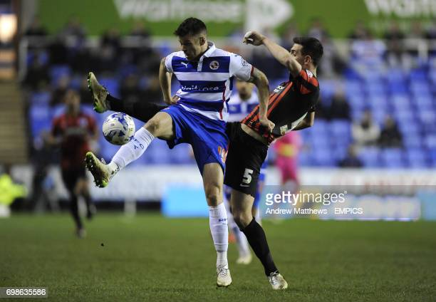 Reading's Jamie Mackie and Brighton and Hove Albion's Lewis Dunk battle for the ball