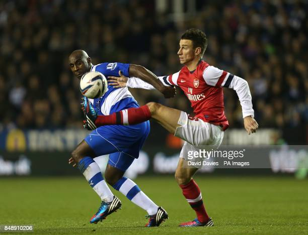 Reading's Jason Roberts and Arsenal's Laurent Koscielny battle for the ball