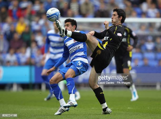 Reading's Jem Karacan and Cardiff City's Peter Whittingham in action
