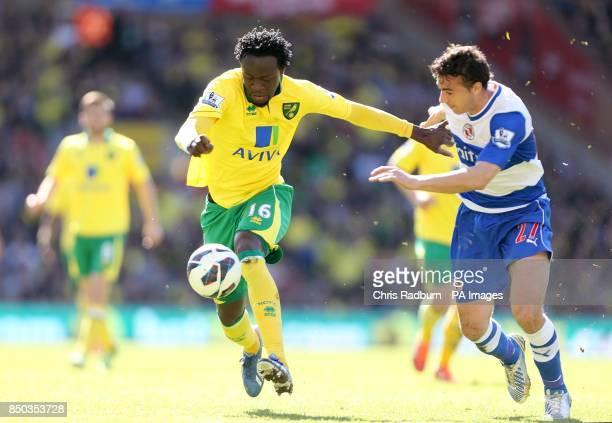 Reading's Jem Karacan and Norwich City's Kei Kamara battle for the ball