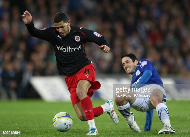 Reading's Jobi McAnuff skips past Cardiff City's Peter Whittingham on his way to scoring