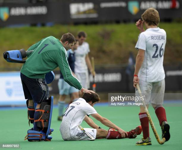 Reading's keeper Jamie Legg pats the head of Saint Germain's Kevin Mercurio during the EuroHockey League Round 12 game at East Grinstead HC West...