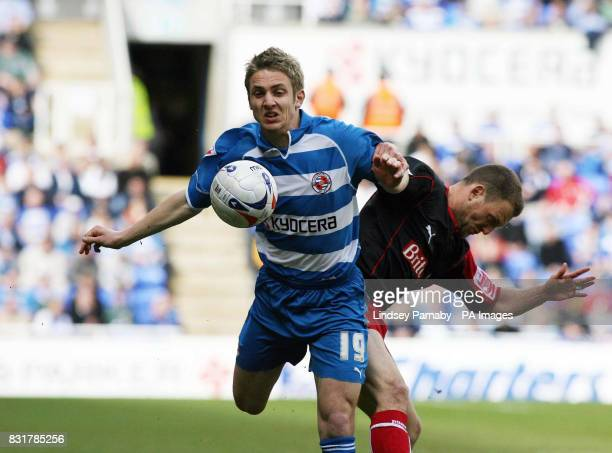 Reading's Kevin Doyle and Stoke's Clint Hill in action during the CocaCola Championship match at the Madejski Stadium Reading