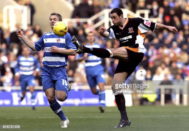 Reading's Kevin Doyle battles for the ball with Damien Delaney of Hull during the CocaCola Championship match at the Madejski Stadium Reading...
