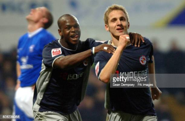 Reading's Kevin Doyle celebrates his goal with teammate Leroy Lita as Ipswich Town's Jason De Vos looks dejected during the CocaCola Championship...