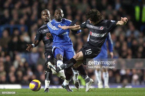 Reading's Leroy Lita and Stephen Hunt challenge Chelsea's Claude Makelele for the ball
