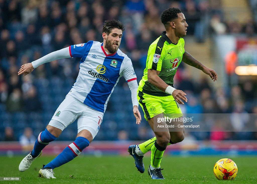 Reading's Liam Moore gets away from Blackburn Rovers' Danny Graham during the Sky Bet Championship match between Blackburn Rovers and Reading at Ewood Park on December 17, 2016 in Blackburn, England.