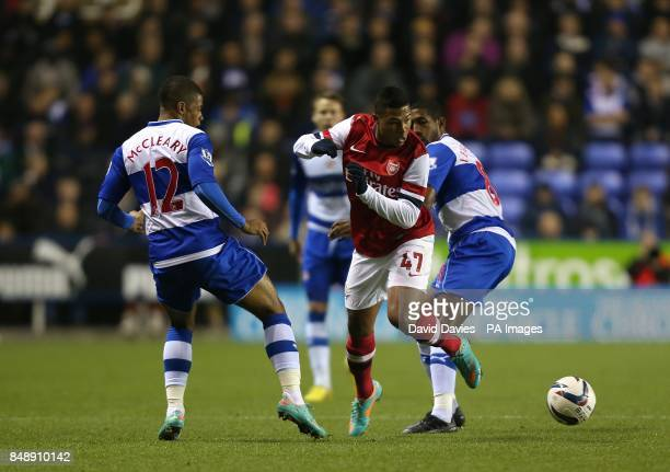 Reading's Mikele Leigertwood and Garath McCleary battle for the ball with Arsenal's Serge Gnabry