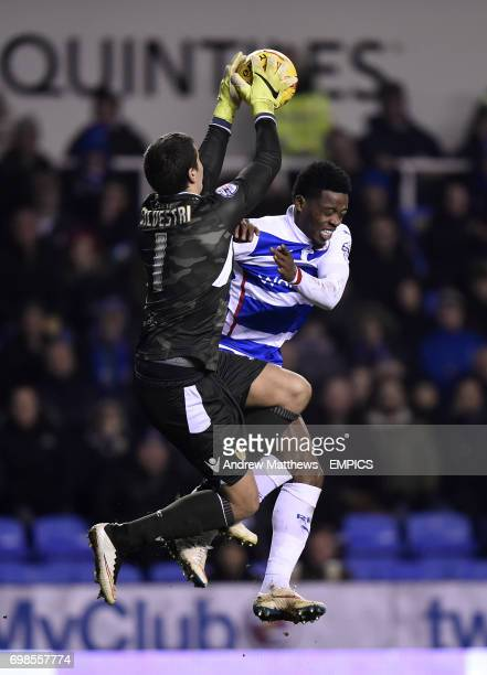 Reading's Nathaniel Chalobah collides with Leeds United goalkeeper Marco Silvestri as they battle for the ball