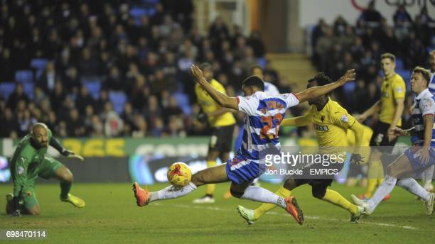 Reading's Nick Blackman is challenged by Watford's Juan Carlos Paredes as he lunges for the ball