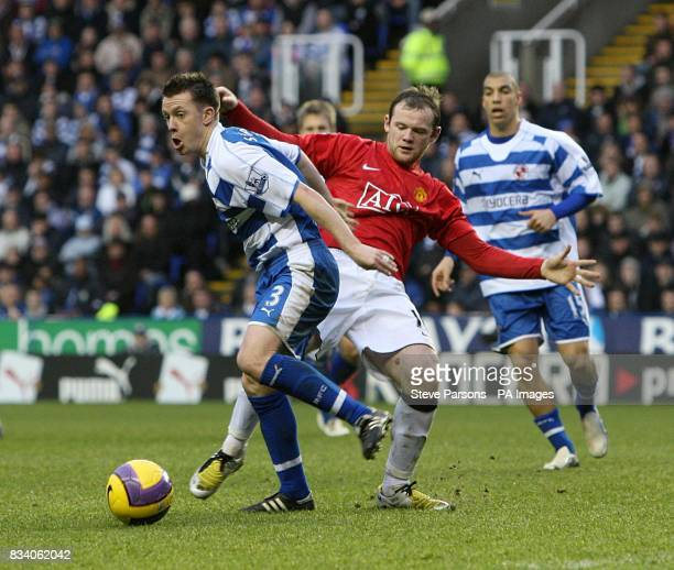 Reading's Nicky Shorey and Manchester United's Wayne Rooney battle for the ball