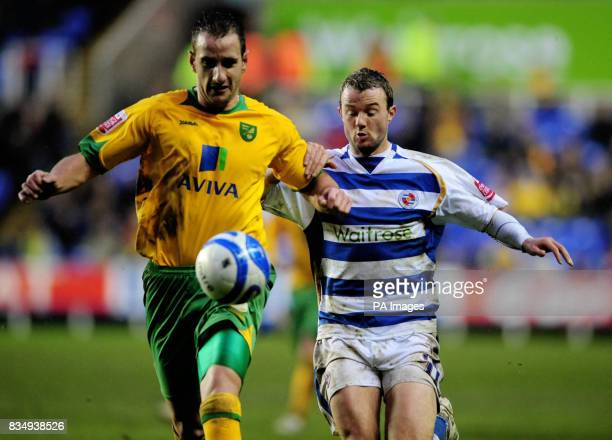Reading's Noel Hunt and Norwich's John Kennedy during the CocaCola Championship match at Madejski Stadium Berkshire