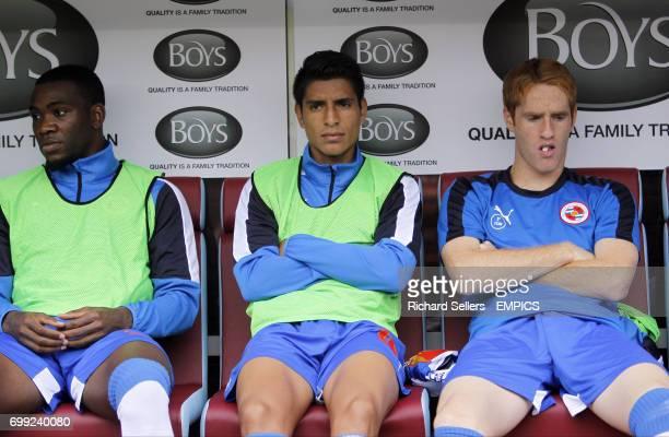 Reading's Ola John Paolo Hurtado and Alex Fernandez on the bench