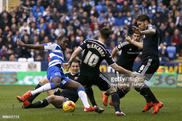 Reading's Ola John with a shot on goal despite the attentions of Brentford's James Tarkowski Josh McEachran and Harlee Dean