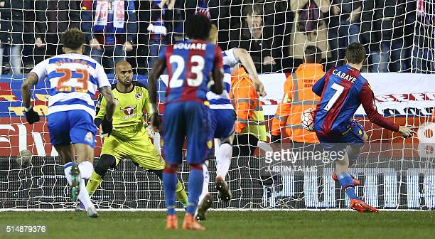 Reading's Omani goalkeeper Ali AlHabsi watches as Crystal Palace's French midfielder Yohan Cabaye scores his team's first goal from the penalty spot...
