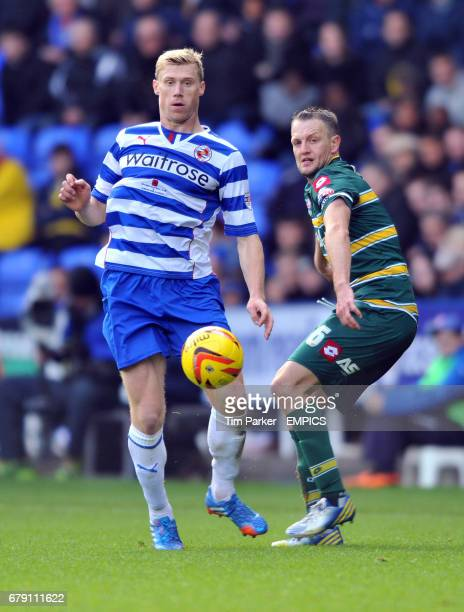 Reading's Pavel Pogrebnyak and QPR's Gary O'Neil challenge for the ball