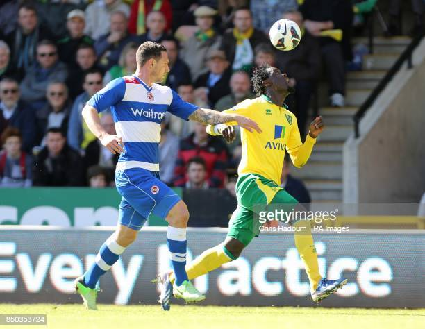 Reading's Sean Morrison and Norwich City's Kei Kamara battle for the ball