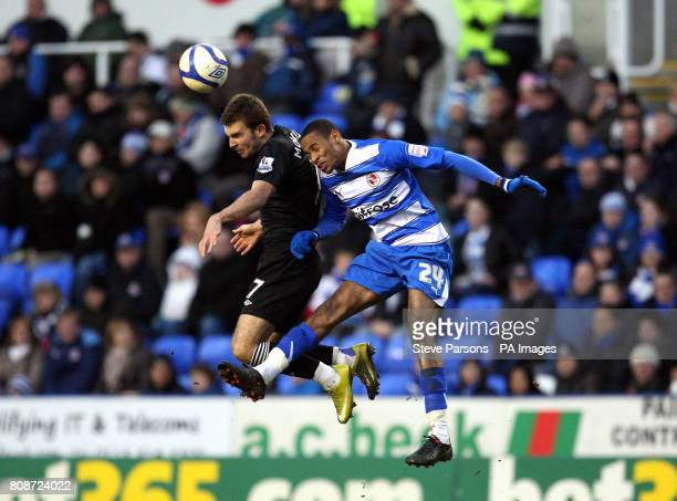 Reading's Shaun Cummings jumps for the ball with West Bromwich Albion's James Morrison during the FA Cup Third round match at the Madjeski Stadium...