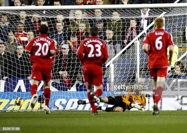 Reading's Stephen Hunt sends Liverpool's goalkeeper Jose Reina the wrong way as he scores the opening goal of the game from the penalty spot