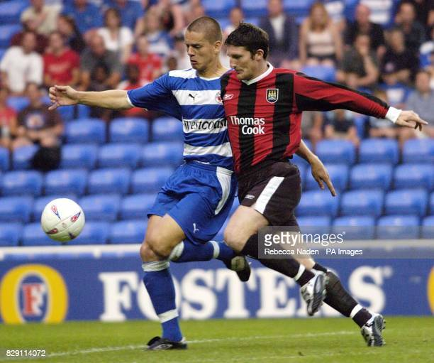 Reading's Steve Sidwell in action against Manchester City's Jonathan Macken during the preseason friendly match at the Madejski Stadium Reading THIS...